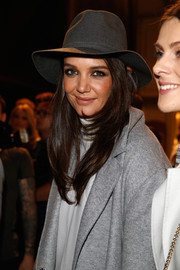 Katie Holmes jazzed up her look with a gray fedora when she attended the Marc Cain fashion show.