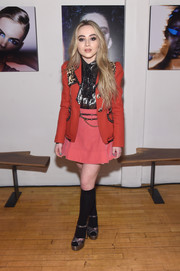 Sabrina Carpenter topped off her outfit with an embellished brick-red jacket.