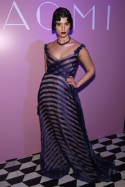 Crystal Renn donned a striped purple gown with beaded shoulder straps for the Naomi celebration.