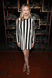 Halston Sage opted for a boldly striped mini dress by Marc Jacobs when she attended the Divine Decadence event.