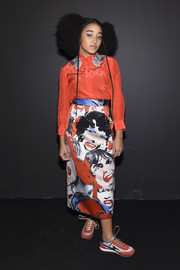 Amandla Stenberg chose a red silk button-down to pair with her funky skirt.