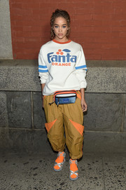 Jasmine Sanders kept it super casual in a 'Fanta Orange' sweatshirt by Marc Jacobs during the brand's Fall 2018 show.