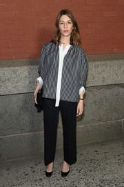 Sofia Coppola paired a striped blouse with black trousers for the Marc Jacobs fashion show.