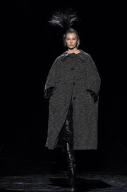 Karlie Kloss looked like she just stepped out of a period film in her voluminous charcoal tweed coat.