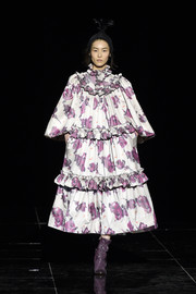 A pair of ruched purple ankle boots completed Liu Wen's runway look.