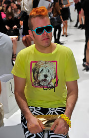 Perez Hilton was colorful, as usual, in a bright yellow shirt and blue-rimmed designer shield sunglasses at the Marc Jacobs fashion show.