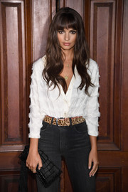 Emily Ratajkowski teamed an animal-print belt with black jeans and a white button-down for the Marc Jacobs Spring 2018 show.