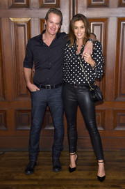 Cindy Crawford rounded out her look with black ankle-strap pumps.
