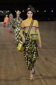 A yellow nylon shoulder bag provided some sporty appeal.