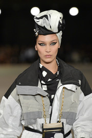 Bella Hadid looked very cosmopolitan wearing this black-and-white silk head scarf while walking the Marc Jacobs show.
