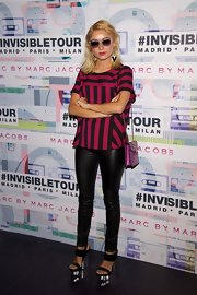 Miranda chose a hot pink and black striped top for her cool mod look at the Marc by Marc Jacobs eyewear launch in Madrid.