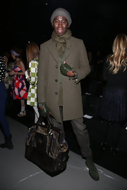 J. Alexander added some edge to his classic look with green leather, fingerless gloves.