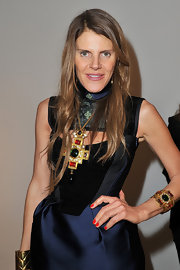 Anna dello Russo attened the unveiling of the Pentax K-01 camera wearing a bold tomato-red nail polish.