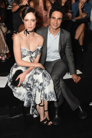 Coco Rocha sat front row at the Marchesa fashion show looking chic in black ankle-strap sandals and a strapless floral dress.
