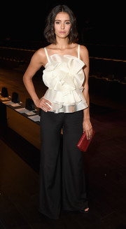 Nina Dobrev went ultra sweet in a white ruffle cami by Marchesa during the brand's fashion show.