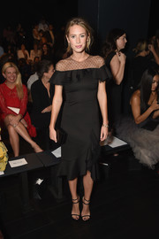 Dylan Penn was ladylike and elegant in a black ruffle dress with a sheer yoke at the Marchesa fashion show.