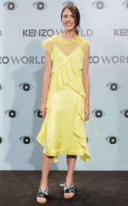 Margaret Qualley attended the Kenzo summer party wearing a cute yellow ruffle dress from the brand.