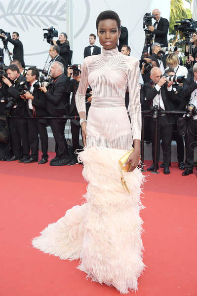 Maria Borges Tasselled Clutch [the beguiled,flooring,gown,carpet,shoulder,fashion model,joint,red carpet,dress,fashion,haute couture,red carpet arrivals,maria borges,screening,cannes,france,cannes film festival,palais des festivals]
