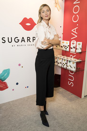 Maria Sharapova kept it simple in an ivory silk button-down while celebrating the Sugarpova chocolate line expansion.
