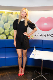 Maria Sharapova looked adorable and flirty in this black romper that featured rounded, puffed sleeves and a white collar.