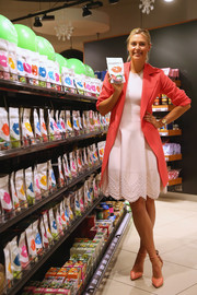Maria Sharapova amped up the sweetness in a pink coat layered over a lovely white cocktail dress for the launch of her candy brand in Sochi.