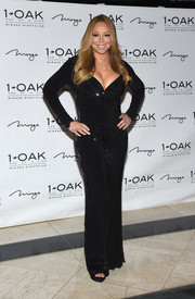 Maria Carey looked va-va-voom, as always, in a cleavage-baring, figure-hugging beaded gown by Camille Flawless during an event at 1 OAK Nightclub.