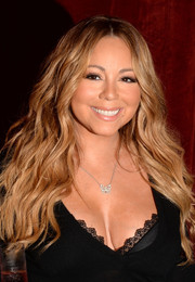 Mariah Carey sported mermaid waves during the launch of her Butterfly beverage.