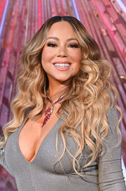 Mariah Carey sported a long curly 'do while lighting the Empire State Building.