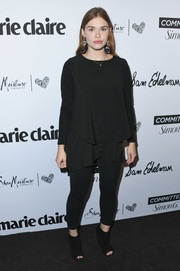 Holland Roden completed her all-black attire with a pair of wedge booties.
