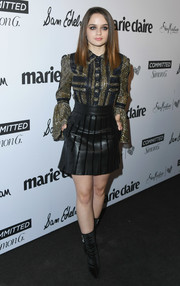 Joey King paired her top with a black leather mini skirt, also by Abodi.