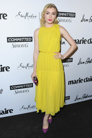 Skyler Samuels looked sunshiny in a sleeveless yellow midi dress by Giambattista Valli at the 2018 Marie Claire Fresh Faces event.
