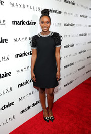 Aja Naomi King was retro-glam at the Marie Claire Fresh Faces celebration in a Miu Miu LBD with a bedazzled neckline and feathered shoulders.
