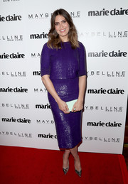 Mandy Moore added a bright spot with a mint-green box clutch by Edie Parker.