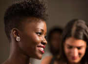 Lupita Nyong'o attended the Marie Claire Fresh Faces Party wearing floral diamond studs by Graziela Gems.