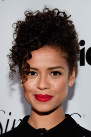 Gugu Mbatha-Raw perked up her beauty look with bright red lipstick.