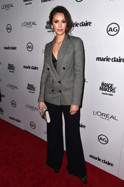 Nina Dobrev opted for a menswear-inspired look with her grey button-down blazer and wide-leg pants at the Marie Claire's Image Maker Awards.