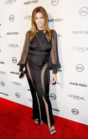 Cindy Crawford dropped jaws in a sheer-panel black dress by Balmain during Marie Claire's Image Maker Awards.