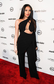 Shay Mitchell flashed an eyeful of skin in a black one-shoulder cutout jumpsuit during Marie Claire's Image Maker Awards.