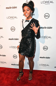Janelle Monae was cool and playful in a tuxedo-style sequin dress by Thom Browne during Marie Claire's Image Maker Awards.