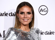 Heidi Klum wore her hair in a straight, center-parted style at the 2018 Image Makers Awards.