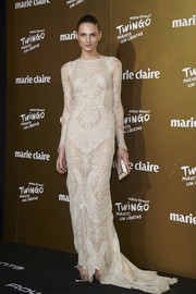 Andreja Pejic paired her lovely dress with a gold-trimmed mother-of-pearl clutch.