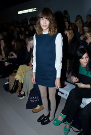 Alexa Chung wore this pair of black patent flats with her lacy tights and innocent dress at the Marios Schwab fashion show.