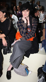 Erin O'Connor, in the front row of the Marios Schwab Spring/Summer 2010 show during London Fashion Week, complemented her outfit with a pair of black patent oxfords.