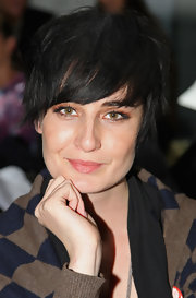 Erin O'Connor sat in the front row of the Marios Schwab Spring/Summer 2010 show during London Fashion Week sporting a short layered hairdo with side-swept bangs.