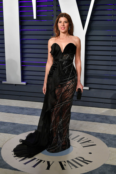 Marisa Tomei Sheer Dress [oscar party,vanity fair,fashion model,clothing,dress,gown,fashion,haute couture,strapless dress,shoulder,formal wear,cocktail dress,beverly hills,california,wallis annenberg center for the performing arts,radhika jones - arrivals,radhika jones,marisa tomei]