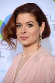 Debra Messing glammed it up with this faux bob at the Joyful Revolution Gala.