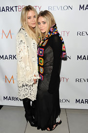 Ashley Olsen draped a multi-colored crocheted scarf over a black dress at the launch party of MARKTBeauty.com in New York City.