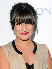 Lea Michele paired her blunt cut bangs with a classic bun for the Markbeauty.com launch.