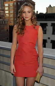 Jennifer Lawrence showed off her long curls while posing for cameras at the MarkBeauty.com launch.