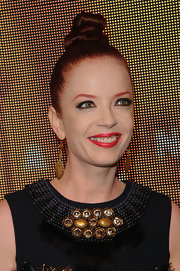 Shirley Manson styled her hair in a  twisted top knot bun that was sleek and modern.